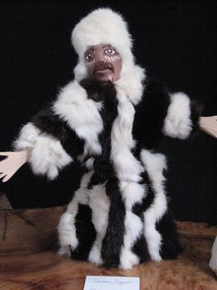 Handmade shaman puppet doll in rabbit fur.