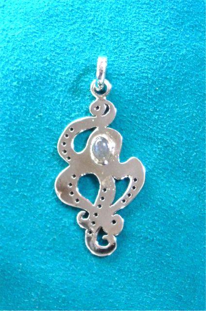 Alaskan Art, silver jewelry, octopus, talismanic pendant