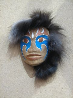 hand carved and painted Shamans face mask with fur