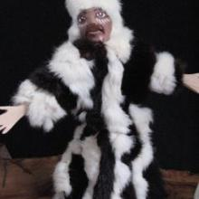 Handmade shaman puppet doll in rabbit fur.